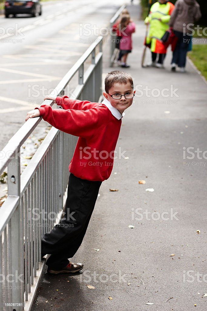 Schoolboy on way home from school royalty-free stock photo