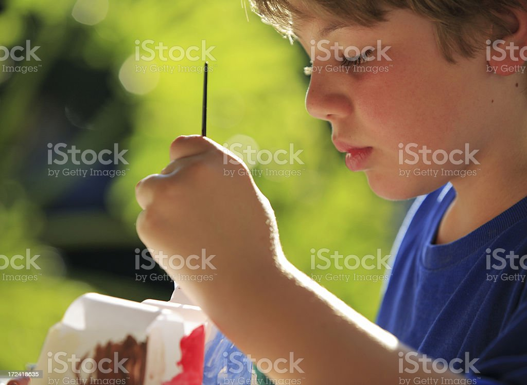 Schoolboy painting royalty-free stock photo