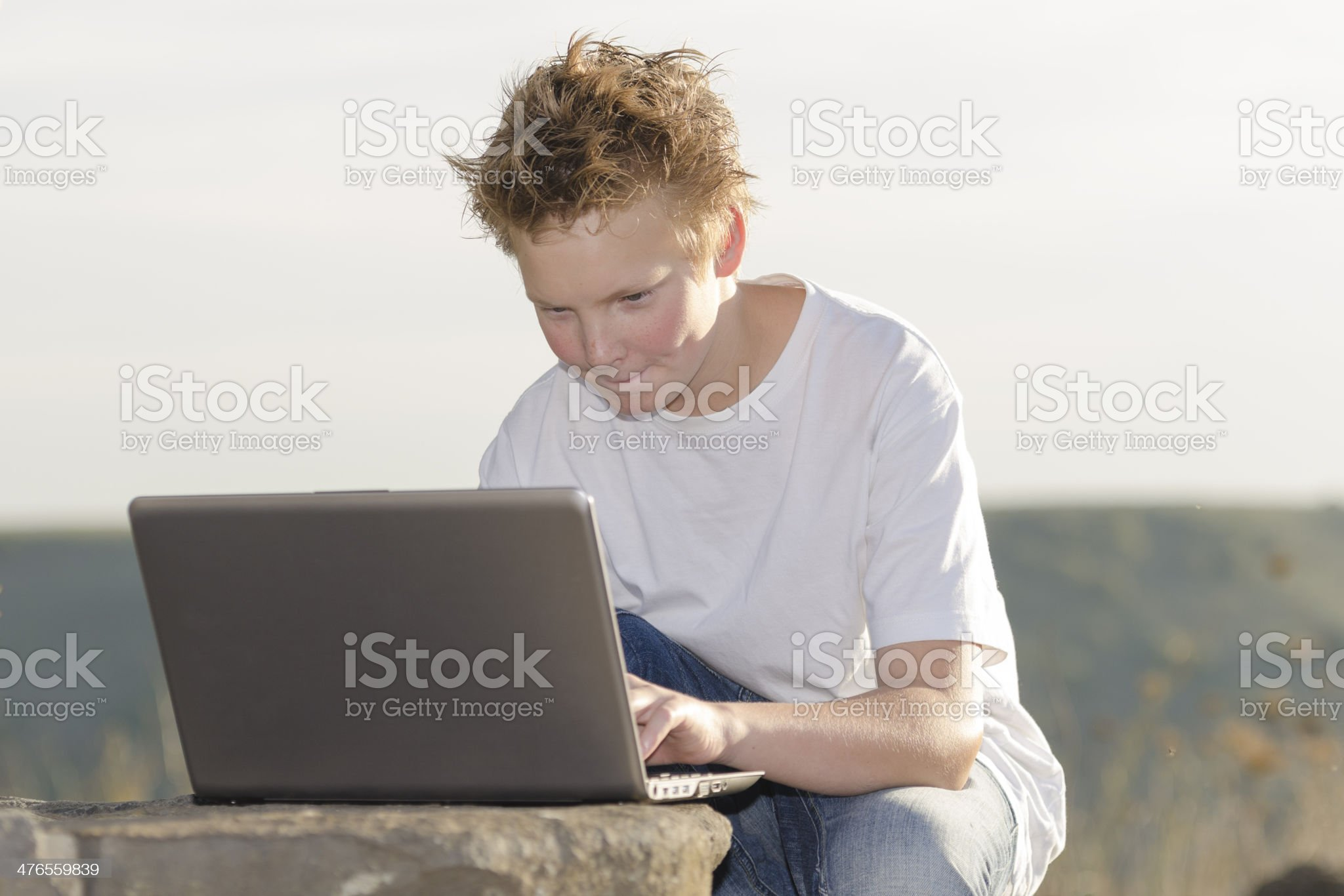 Schoolboy play the game on laptop royalty-free stock photo
