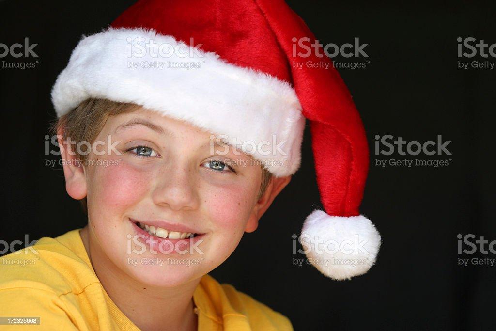 Schoolboy wearing a Santa hat royalty-free stock photo