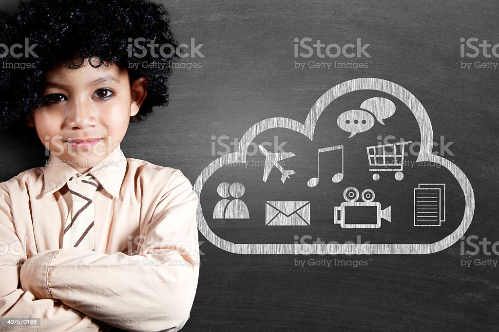 Schoolboy with cloud computing icon drawn on blackboard stock photo