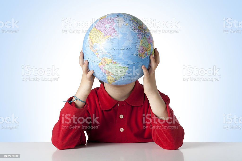 Schoolboy with globe royalty-free stock photo