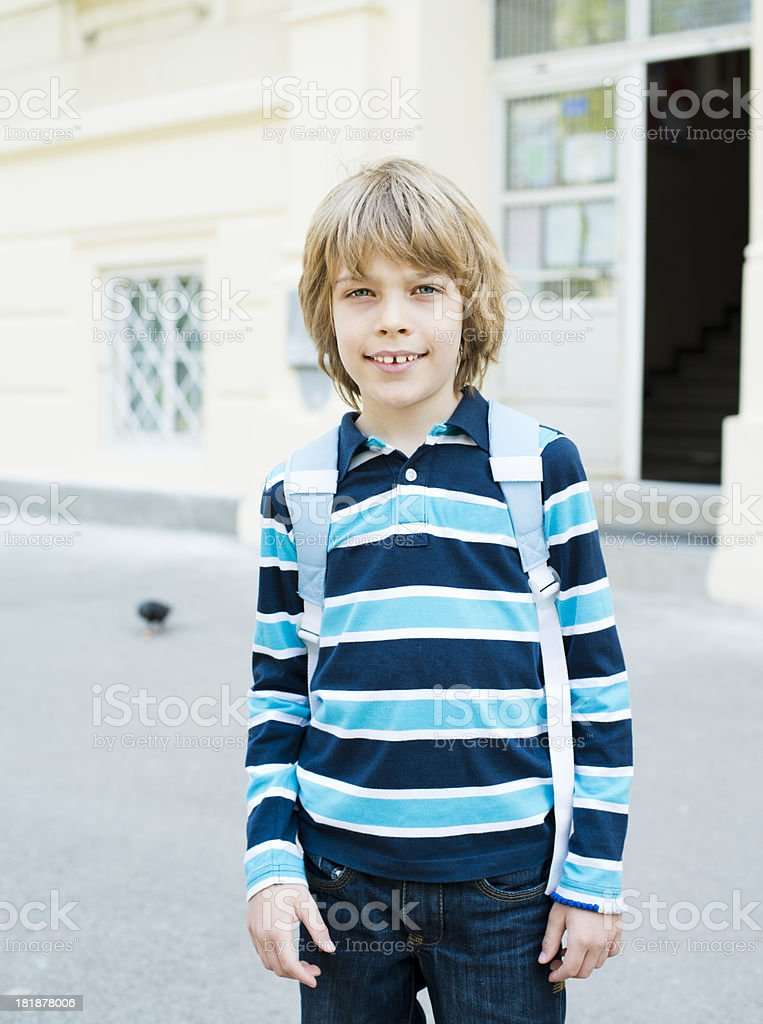 Schoolboy with his bag royalty-free stock photo