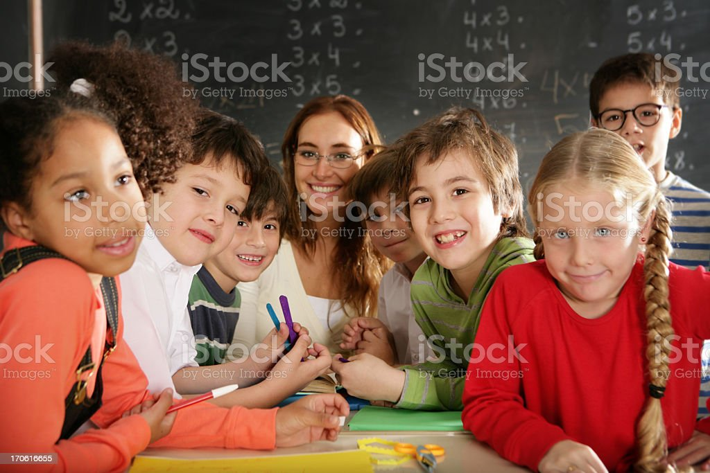 Schoolboys and girls are smiling with teacher royalty-free stock photo