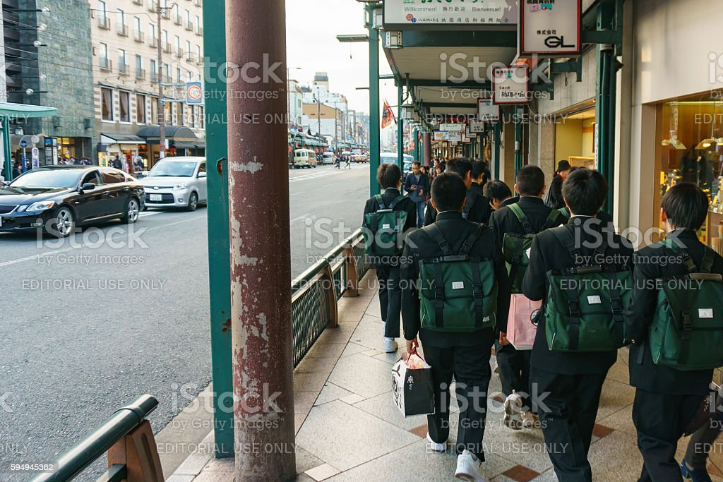 Schoolboys walking on Kyoto street. stock photo