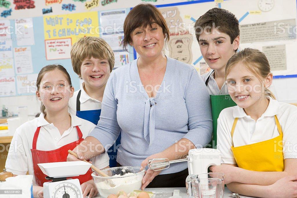 Schoolchildren and teacher in a cooking class stock photo