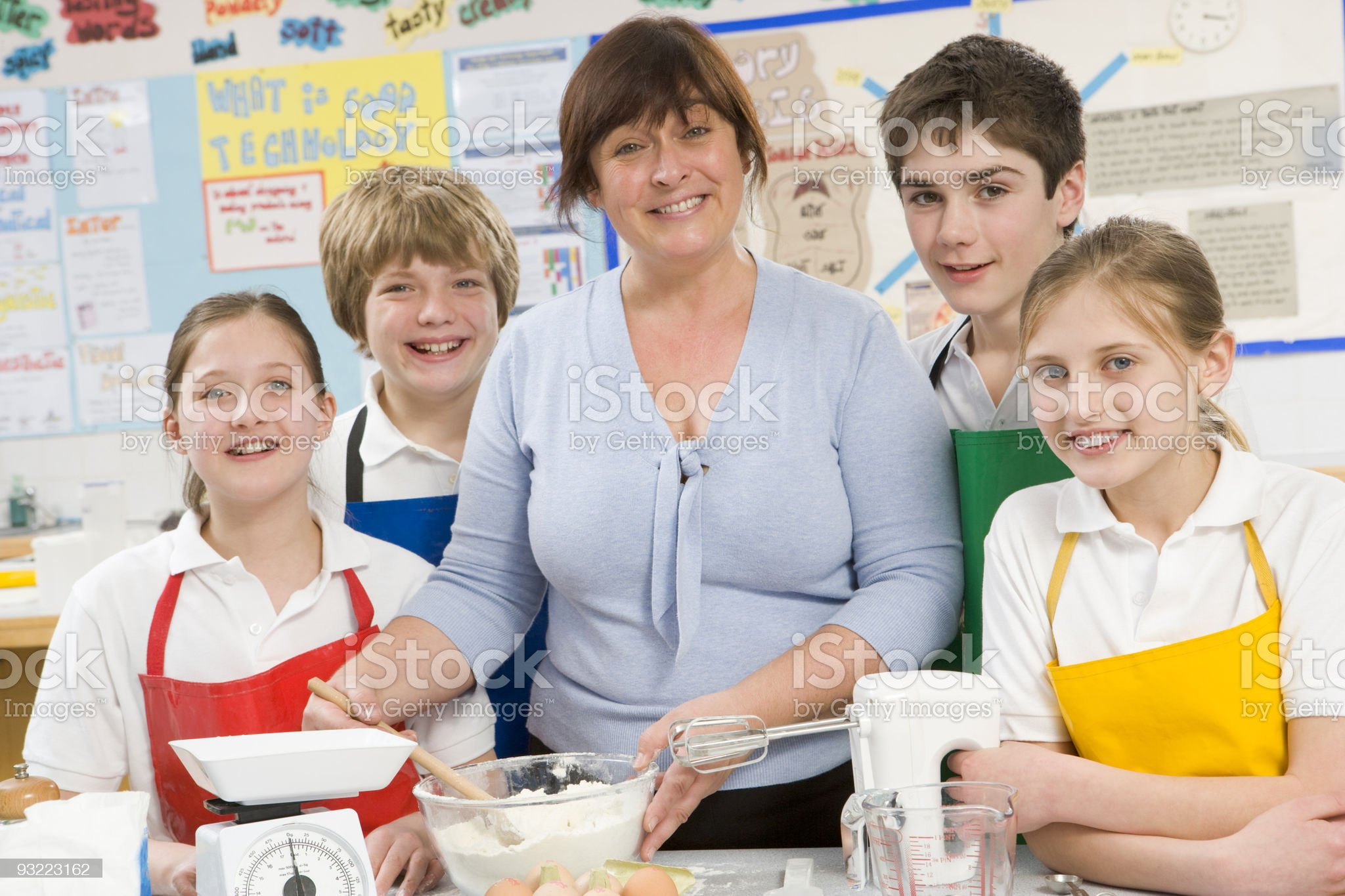 Schoolchildren and teacher in a cooking class royalty-free stock photo