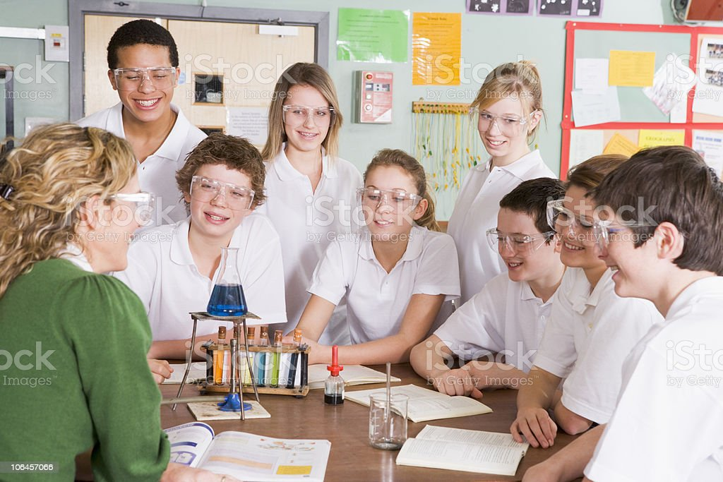 Schoolchildren and Teacher in Science Class stock photo