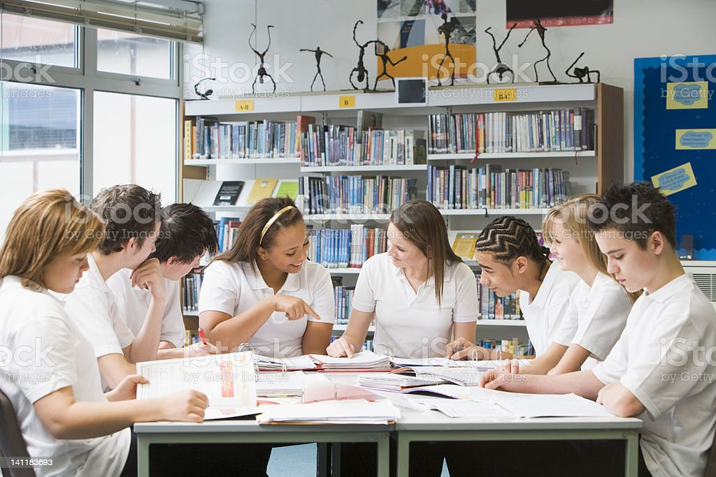 Schoolchildren studying in school library royalty-free stock photo