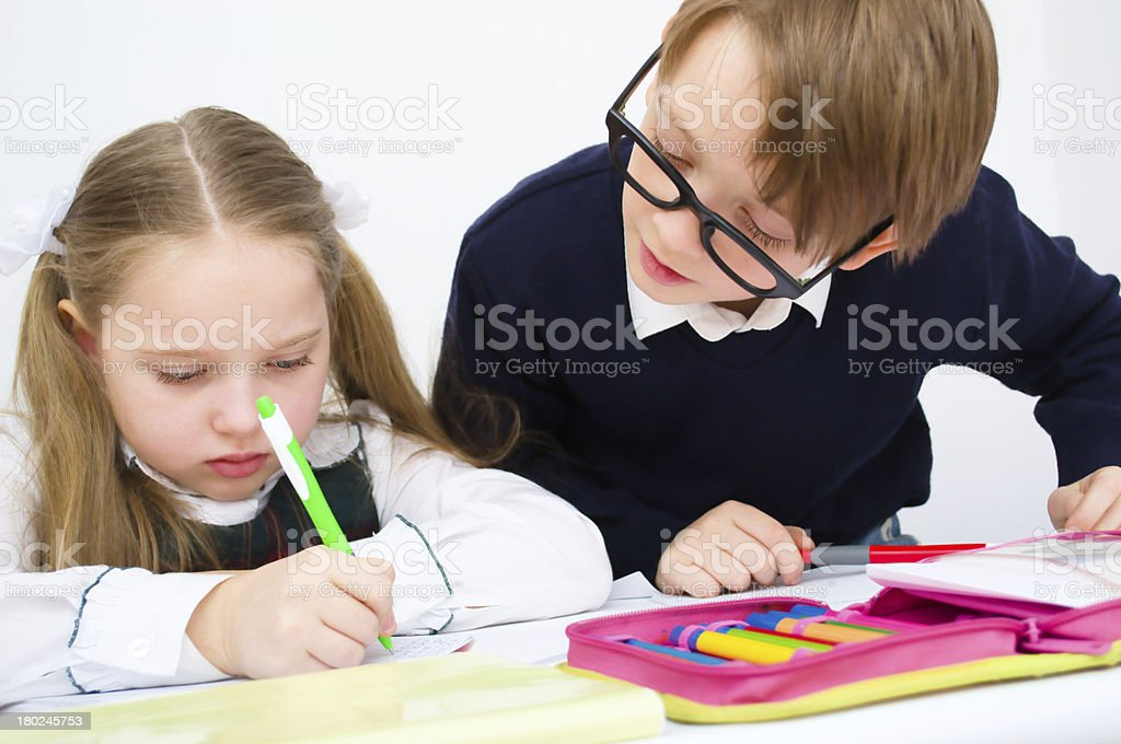 schoolchildren writing in workbook royalty-free stock photo