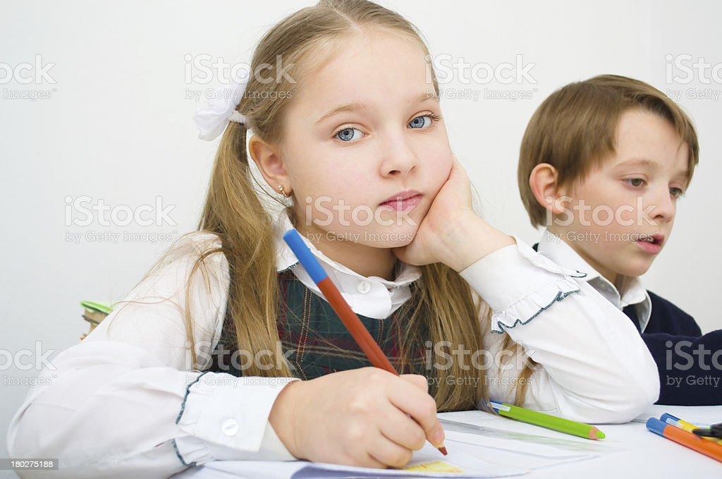 schoolchildren writing in workbook royalty-free stock photo