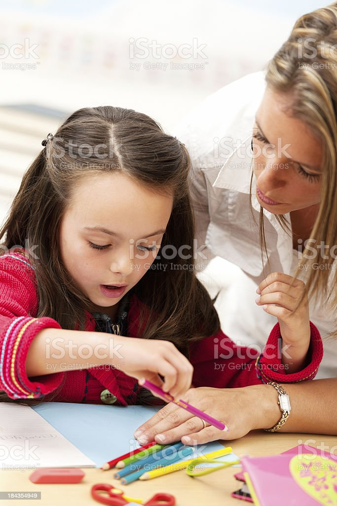 Schoolgirl and teacher royalty-free stock photo