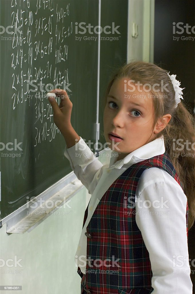 Schoolgirl at the blackboard royalty-free stock photo