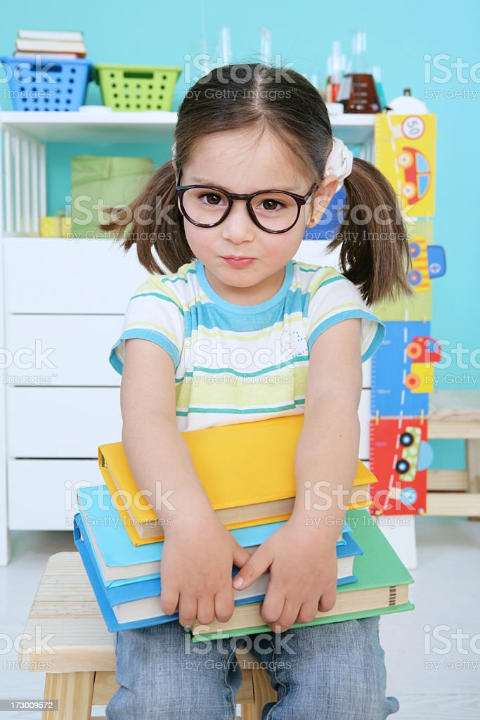 schoolgirl hold textbooks royalty-free stock photo