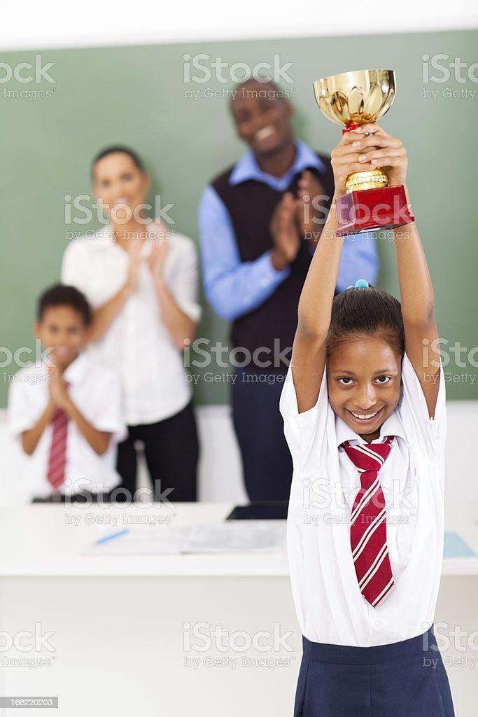 schoolgirl holding a trophy stock photo