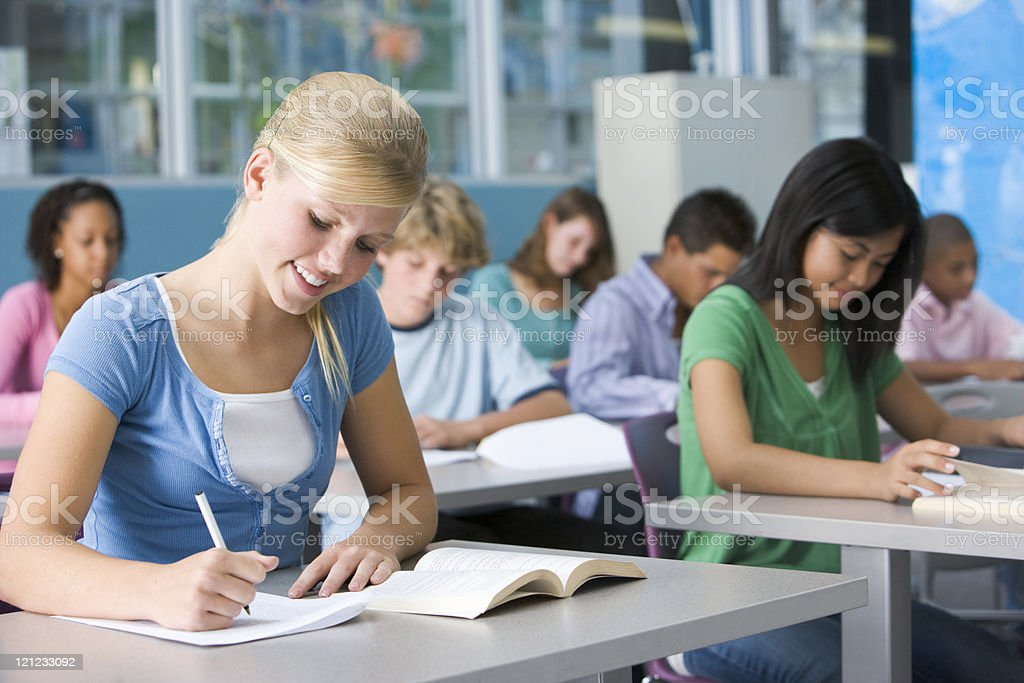 Schoolgirl in high school class stock photo