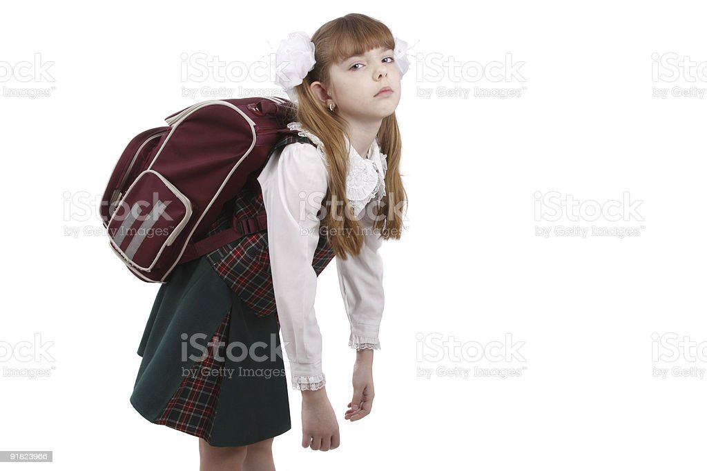 Schoolgirl is tired. Education royalty-free stock photo