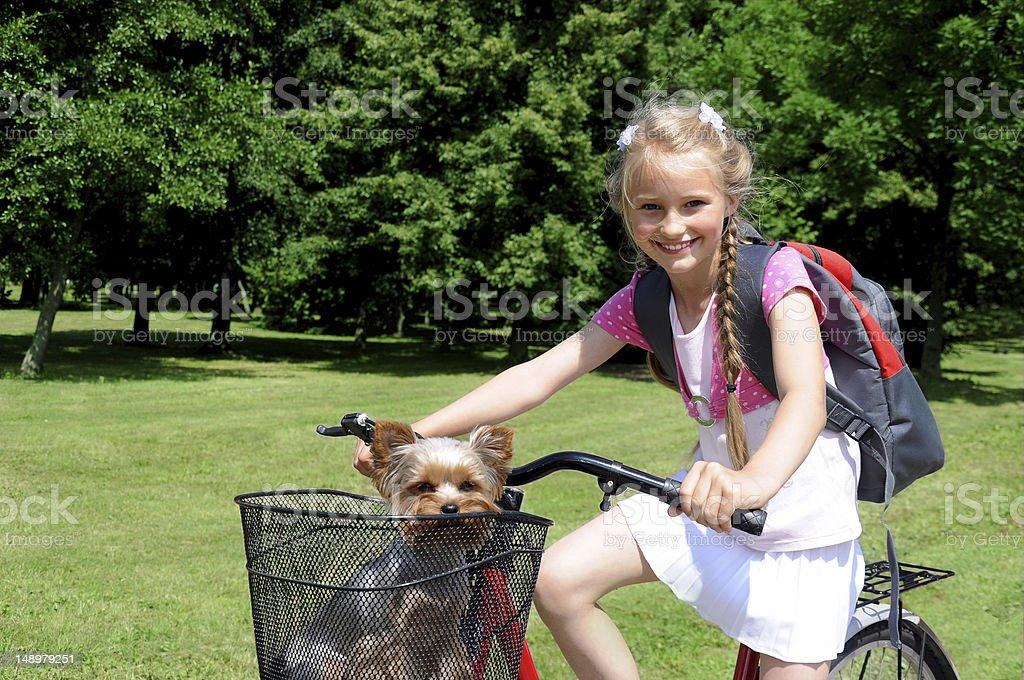 Schoolgirl on a bike stock photo