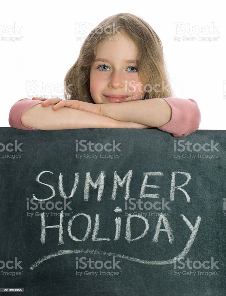 Schoolgirl over blackboard with Summer Holiday text. stock photo