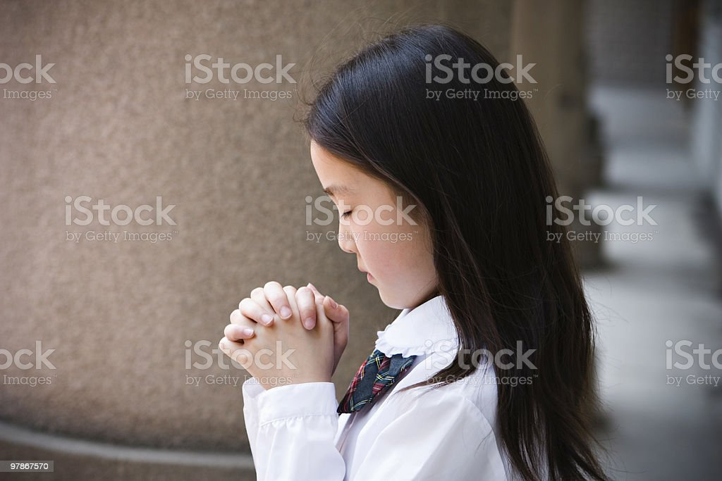 schoolgirl praying royalty-free stock photo