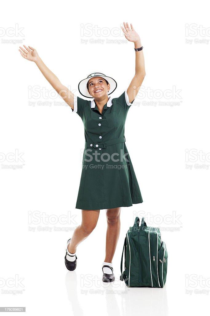 schoolgirl raising her hands and looking up royalty-free stock photo