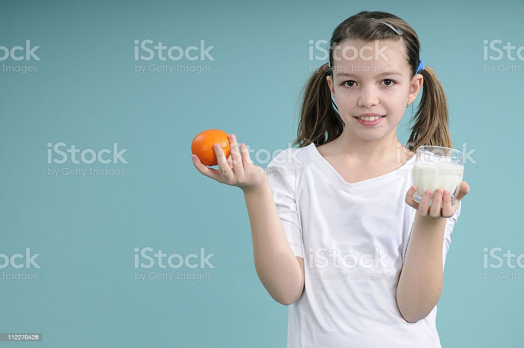 schoolgirl showing fruit and milk royalty-free stock photo