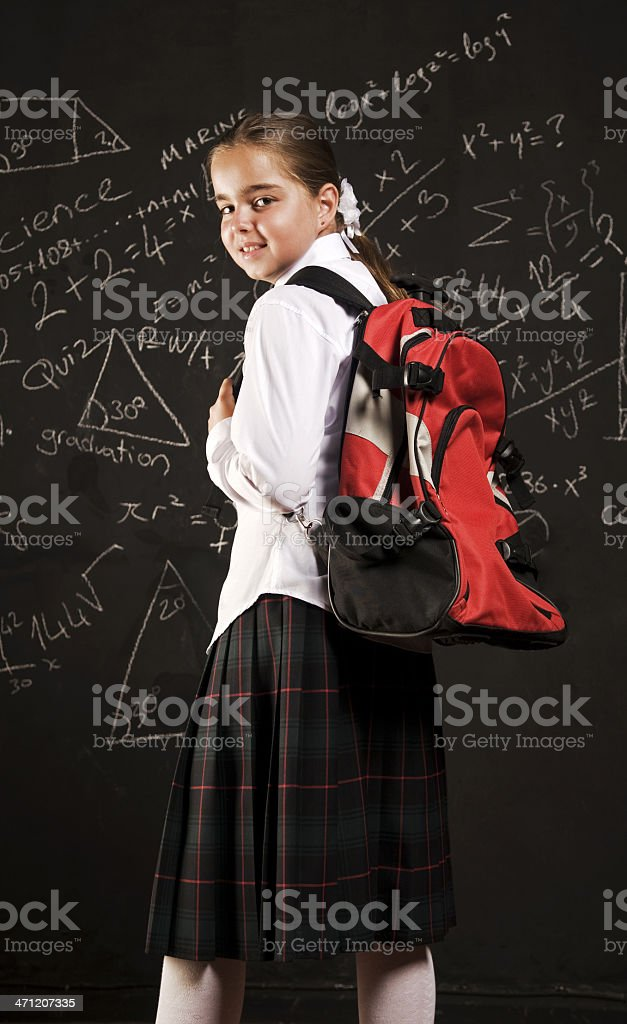 Schoolgirl with backpack royalty-free stock photo