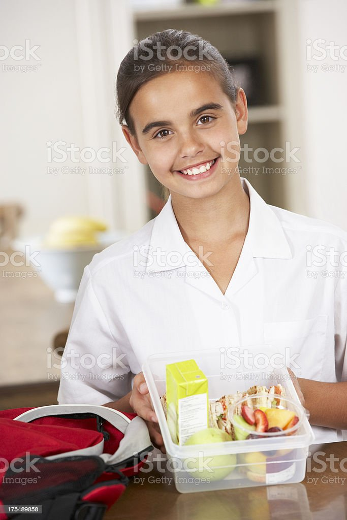 Schoolgirl With Healthy Lunchbox In Kitchen royalty-free stock photo