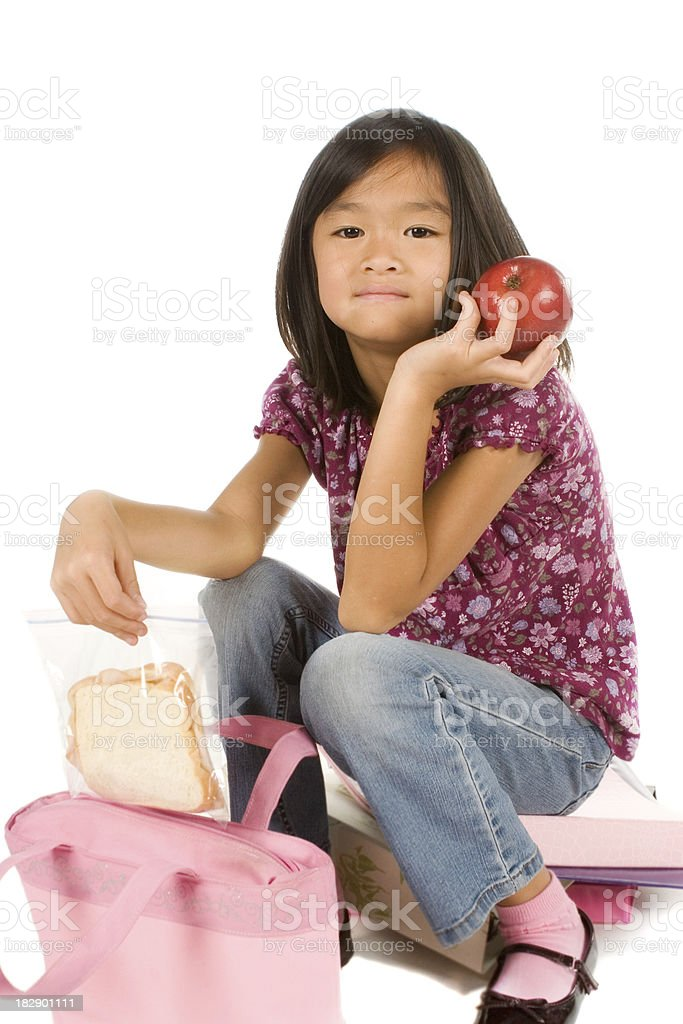 Schoolgirl with sandwich and apple royalty-free stock photo