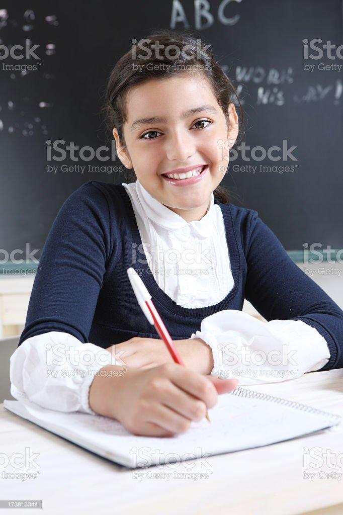 Schoolgirl  writing a test royalty-free stock photo