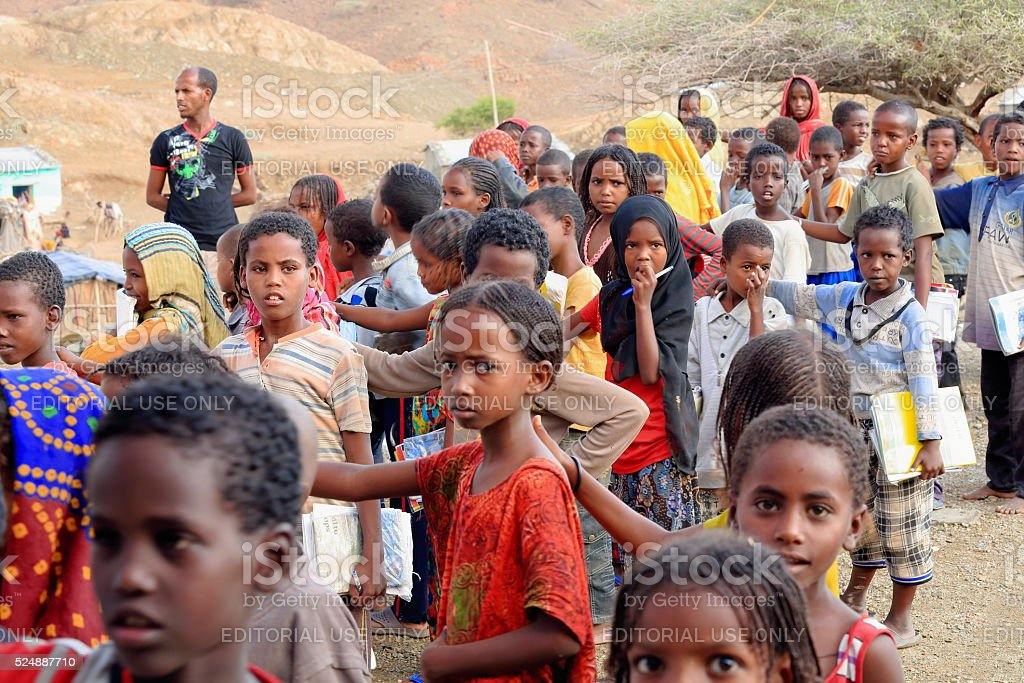 Schoolgirls and boys queuing at the schoolyard. Berahile-Ethiopia. 0382 stock photo