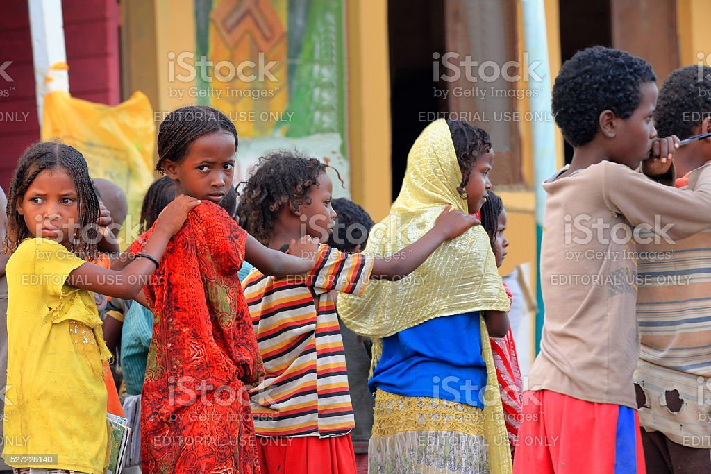 Schoolgirls and boys queuing in the schoolyard. Berahile-Ethiopia. 0390 stock photo