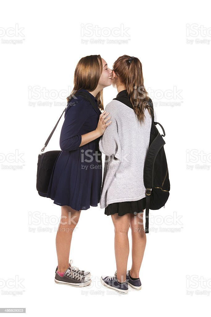 Schoolgirls telling secrets full length isolated royalty-free stock photo