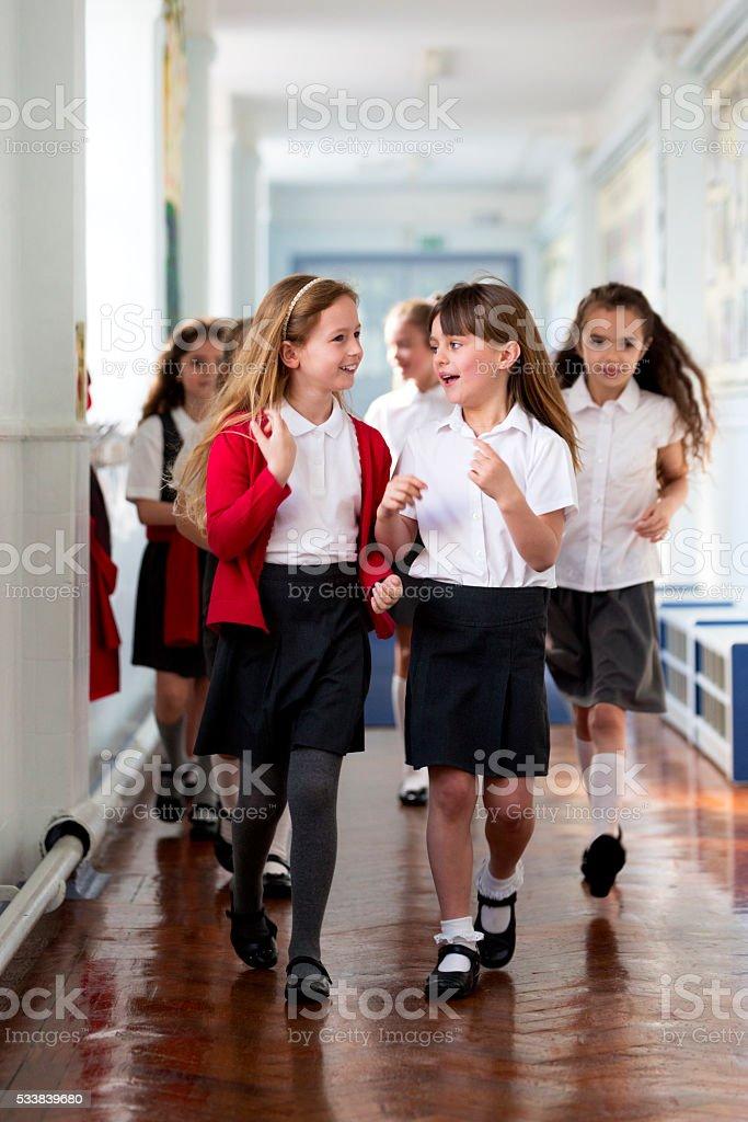 Schoolgirls Walking to Class stock photo