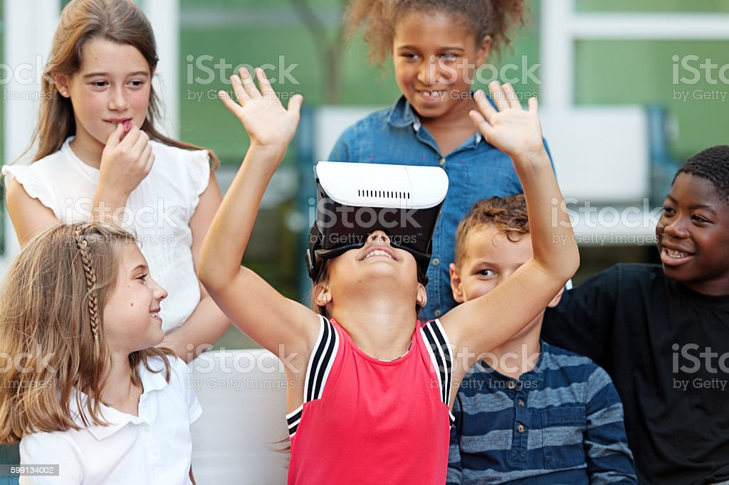 Schoolkids trying Virtual Reality stock photo