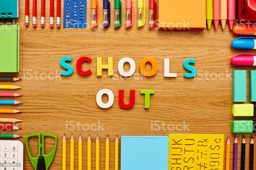 School's out blocks and office supplies on wooden table stock photo