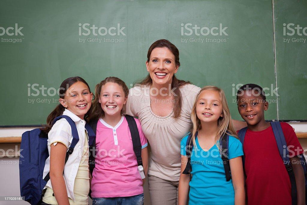 Schoolteacher posing with her pupils stock photo