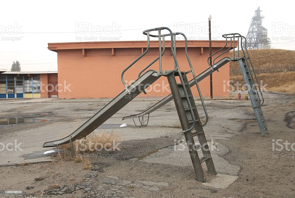 Schoolyard and mine frame in Montana stock photo