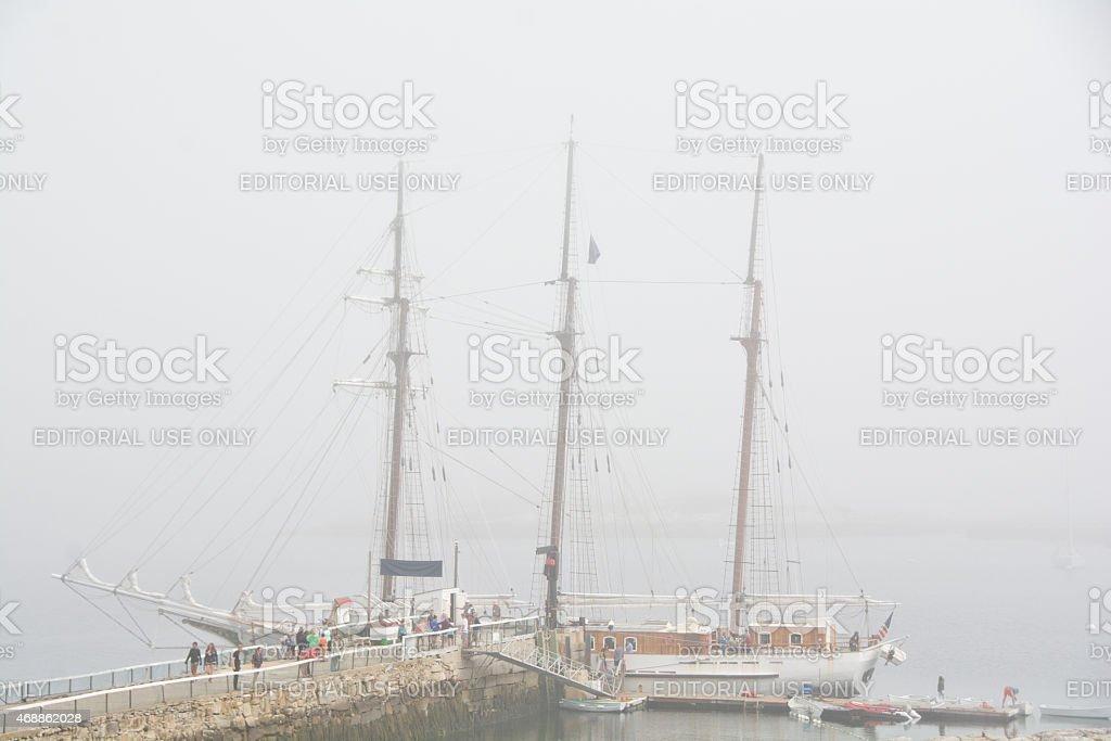 Schooner Mystic docked in mist stock photo