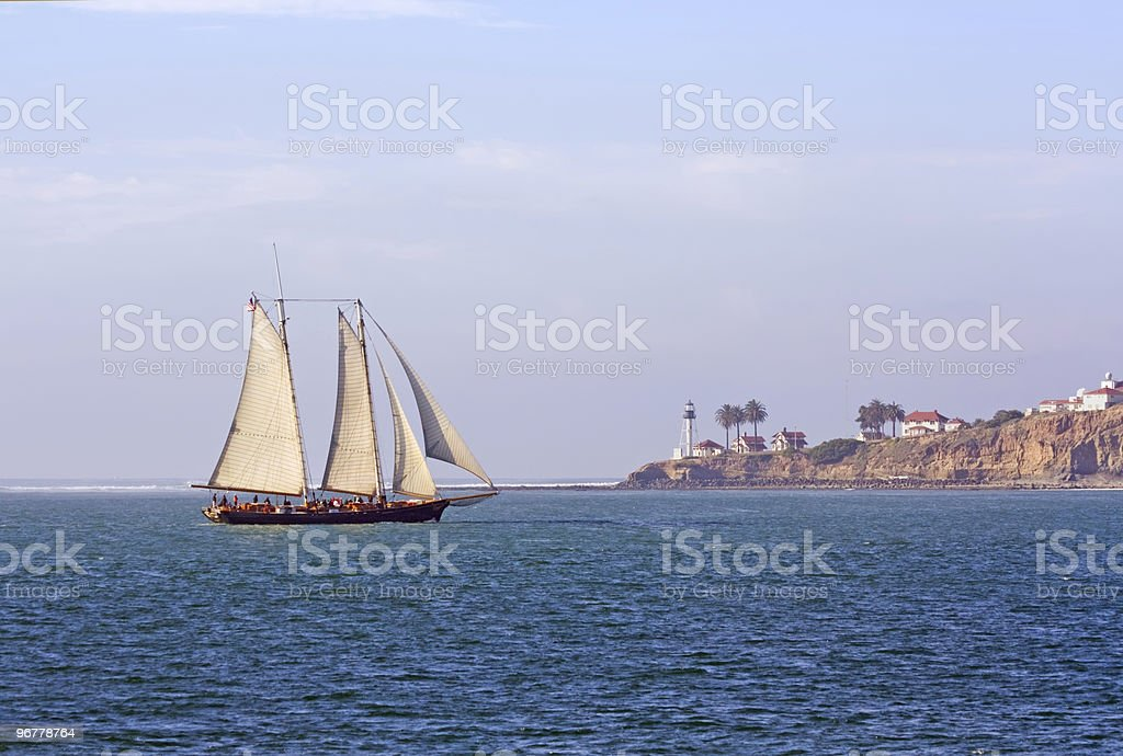 Schooner sails past Point Loma near San Diego, California stock photo