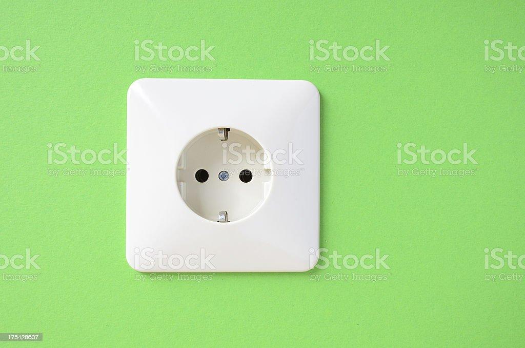 Schuko power socket on green wall stock photo