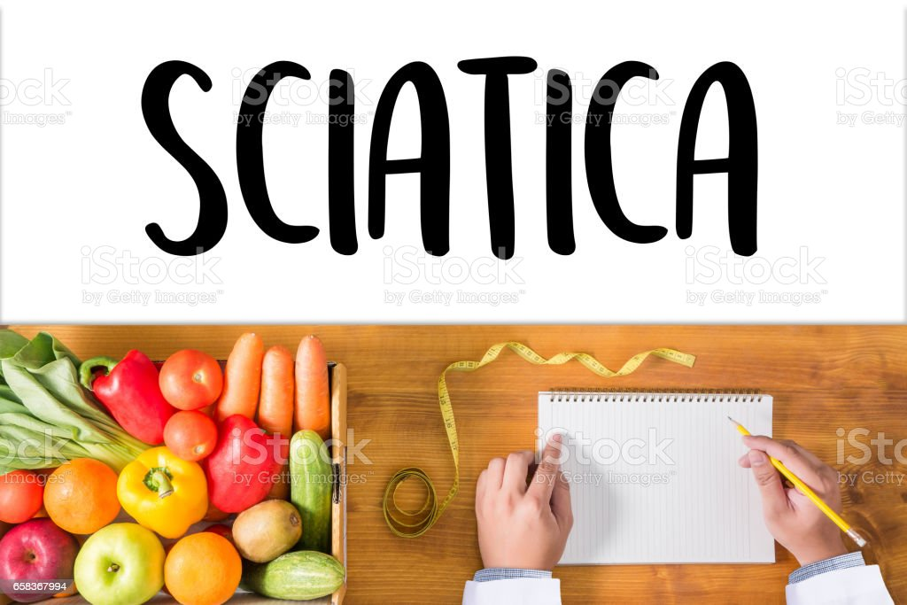 Sciatica doctor hand working Professional Medical Concept stock photo