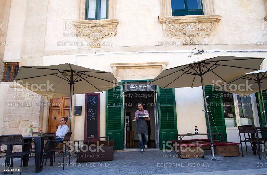 Scicli, Sicily: Barista/Server in Coffee Bar Doorway, Tray of Coffees stock photo