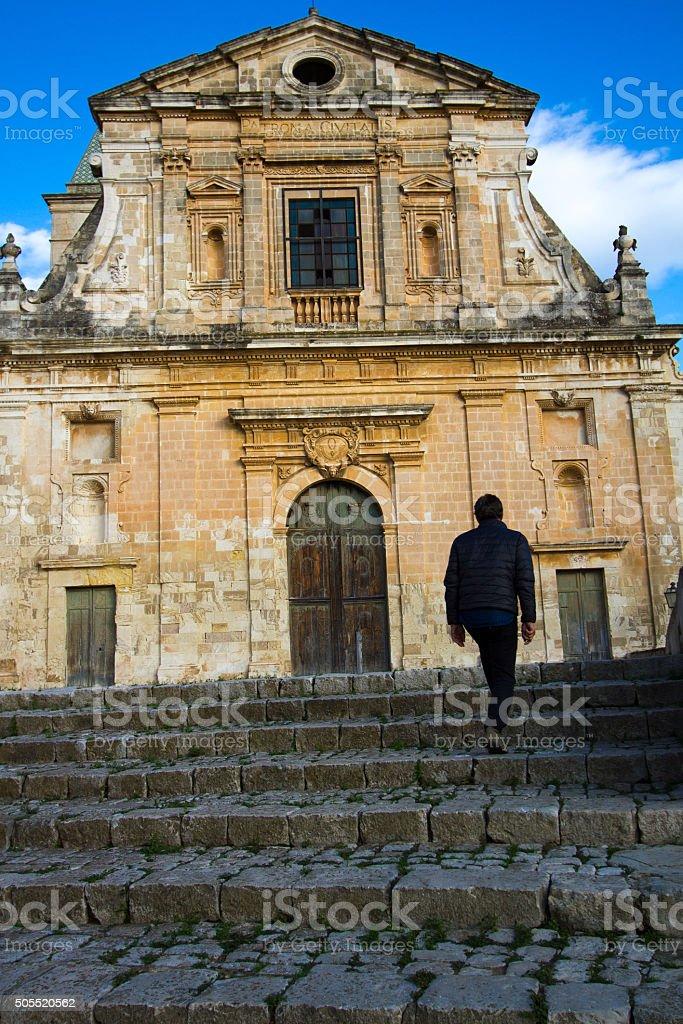 Scicli, Sicily: Man Walking up Steps to Chiesa della Conzolazione stock photo
