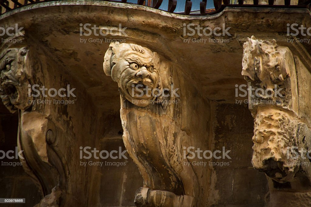 Scicli, Sicily: Ornate Baroque Balcony with Grotesques stock photo