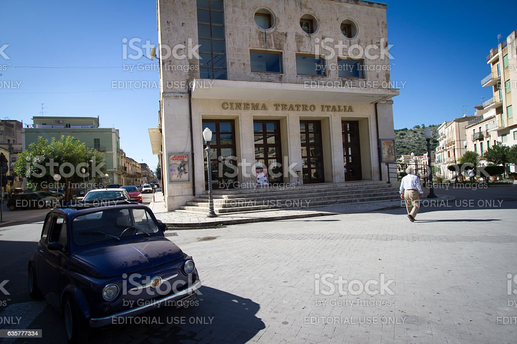 Scicli, Sicily: Sunlit Piazza with Little Car, Cinema/Theater, Pedestrian stock photo