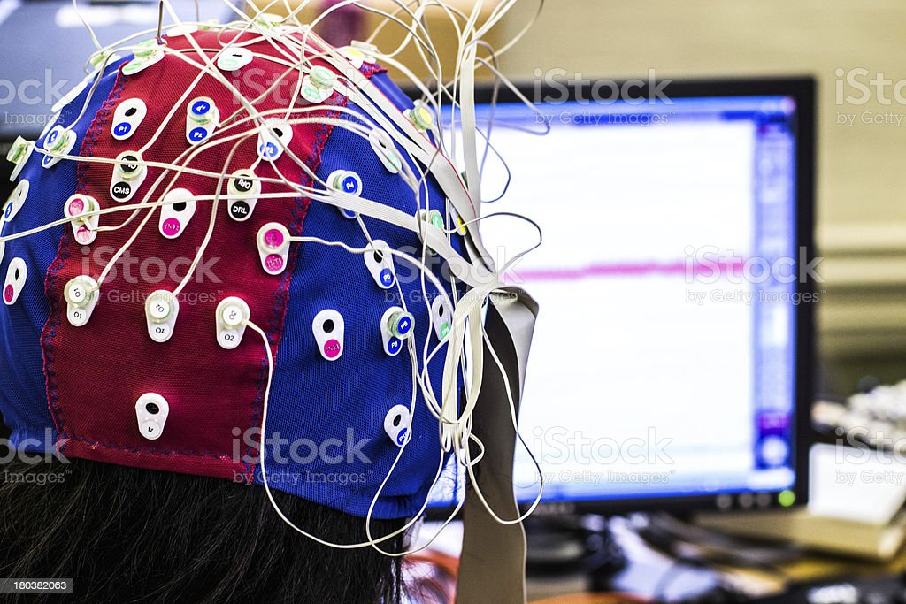 Science experiment with a psychophysiological measuring cap stock photo