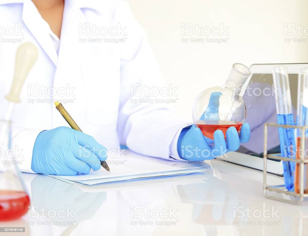 scienctists working  in laboratory focus on finger royalty-free stock photo