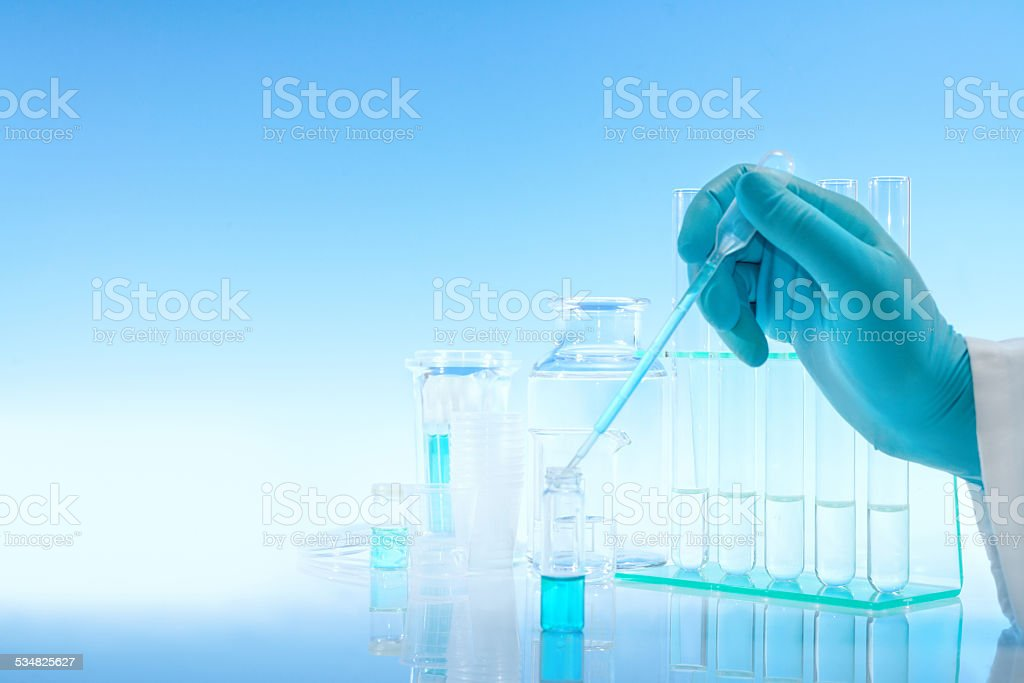 Scientific background with chemical glass, flask and tubes stock photo