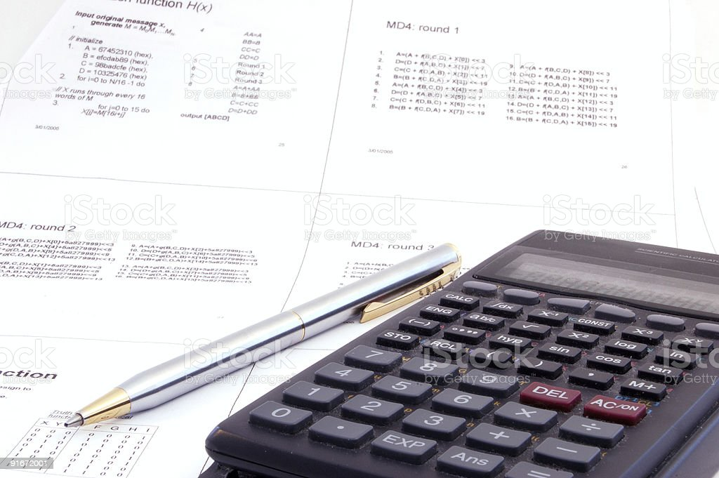 scientific calculator and pen on the lecture note royalty-free stock photo